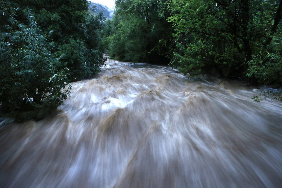 Photo - Boulder Creek roils at high speed after days of record rain and flooding, at the base of Boulder Canyon, Friday Sept. 13, 2013 in Boulder, Colo.   People in Boulder were ordered to evacuate as water rose to dangerous levels amid a storm system that has been dropping rain for a week. Rescuers struggled to reach dozens of people cut off by flooding in mountain communities, while residents in the Denver area and other areas were warned to stay off flooded streets. (AP Photo/Brennan Linsley)