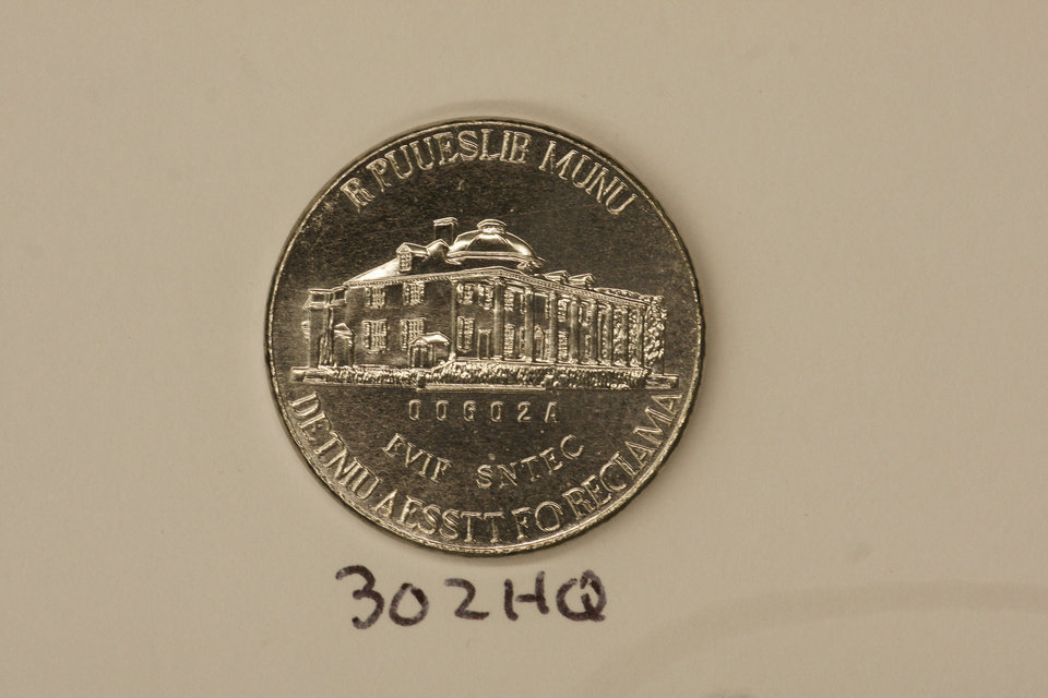 This undated photo provided on Wednesday, Dec. 19, 2012 by the U.S. Mint in Philadelphia shows a nonsense test piece.  The Mint has been testing different materials to fiend less expensive ways to make coins. (AP Photo U.S. Mint) ORG XMIT: PX204