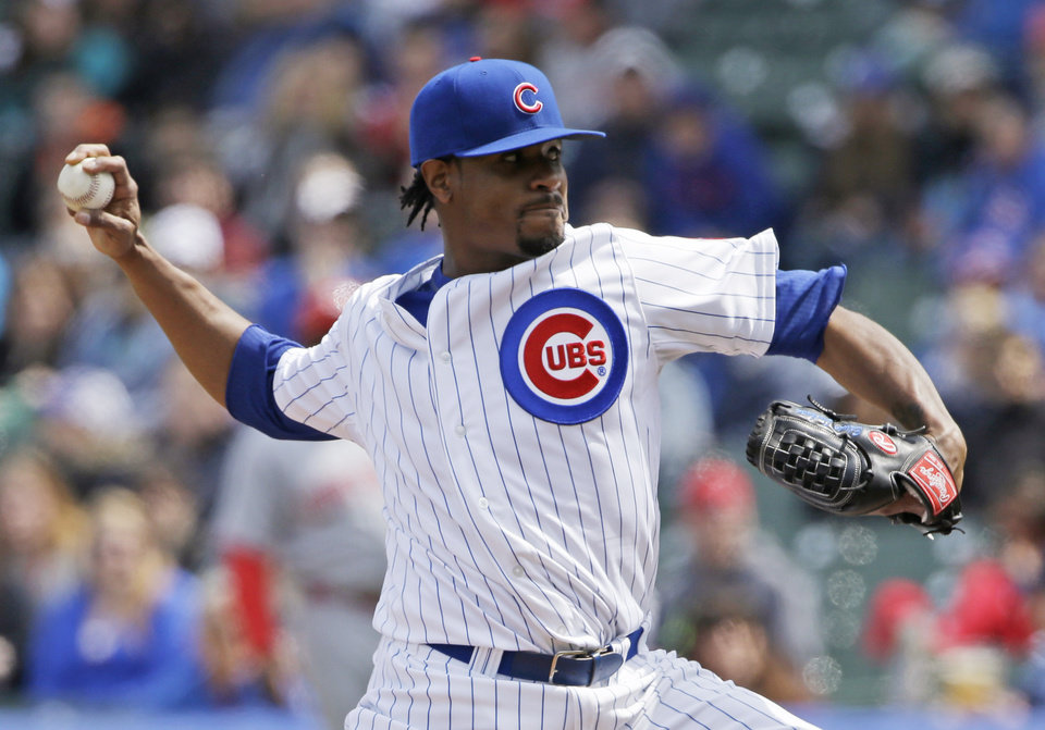 Photo - 2Chicago Cubs starter Edwin Jackson throws against the Cincinnati Reds during the first inning of a baseball game in Chicago, Saturday, April 19, 2014. (AP Photo/Nam Y. Huh)
