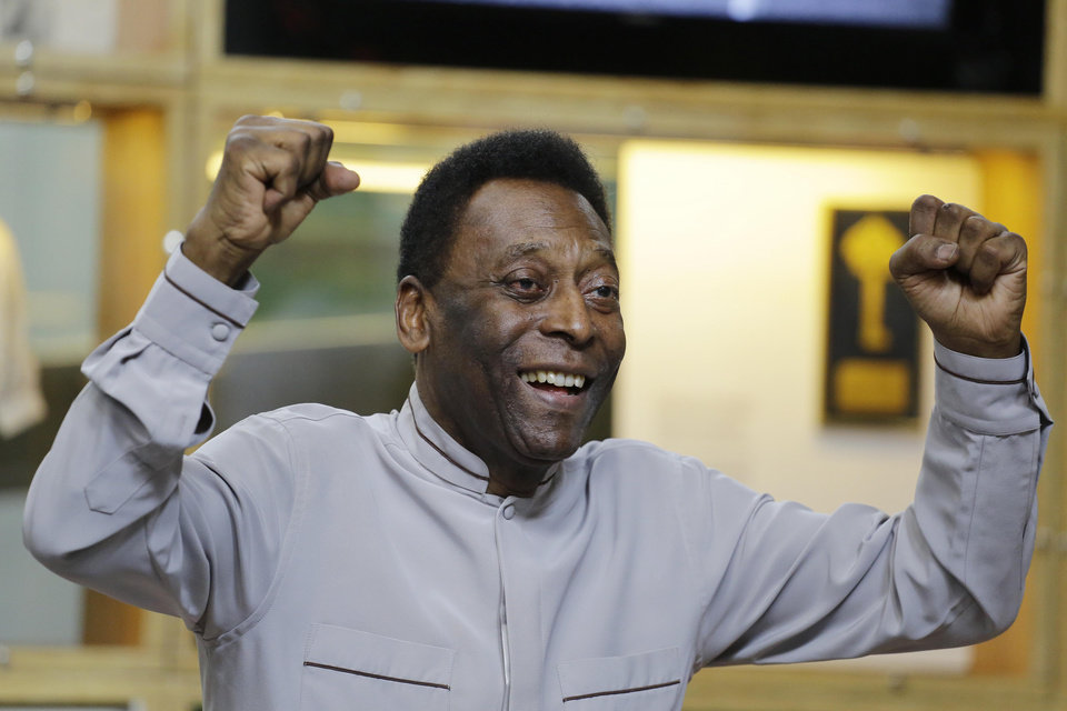 Photo - Soccer great Pele pose for photos during the inauguration of the Pele Museum showing his history as a player in Santos, Brazil, Sunday, June 15, 2014. The Pele Museum exhibits his personal collection, pictures, films, trophies and printed material about his history as a soccer player and personality. (AP Photo/Nelson Antoine)