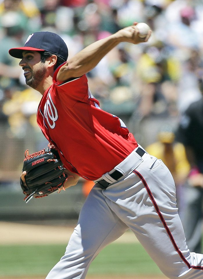 Photo - Washington Nationals starting pitcher Gio Gonzalez throws to the Oakland Athletics during the first inning of a baseball game on Sunday, May 11, 2014, in Oakland, Calif. (AP Photo/Marcio Jose Sanchez)