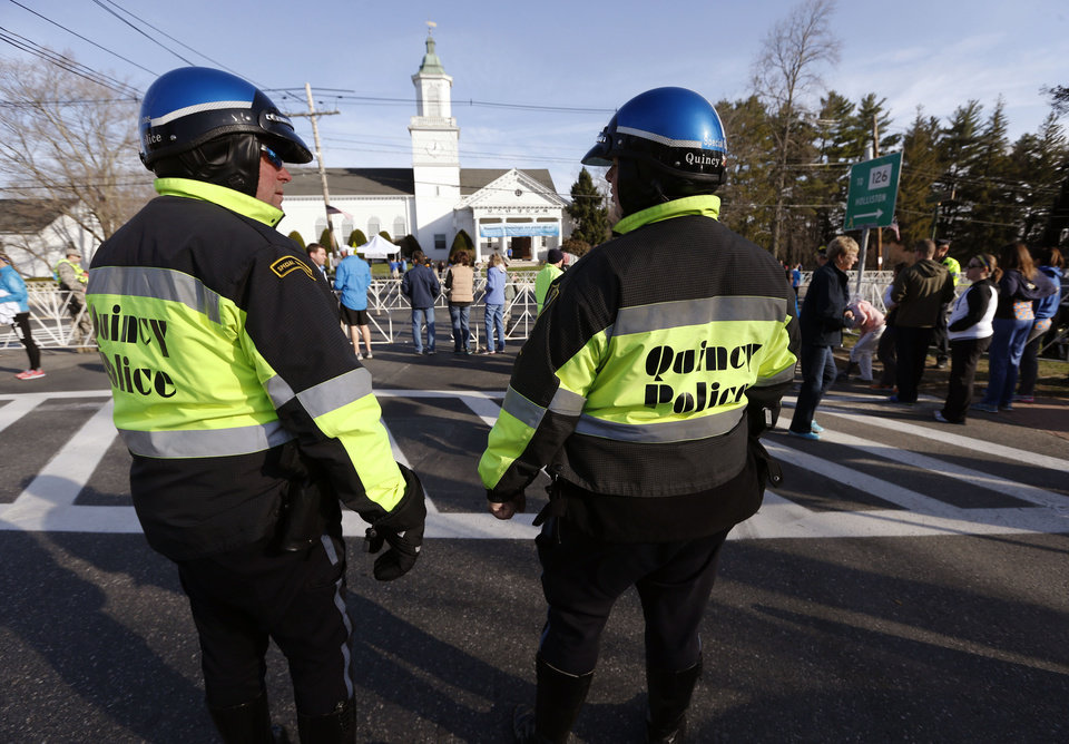 Photo - Quincy, Mass., police stand near the starting line of the 118th Boston Marathon Monday, April 21, 2014 in Hopkinton, Mass. (AP Photo/Michael Dwyer)