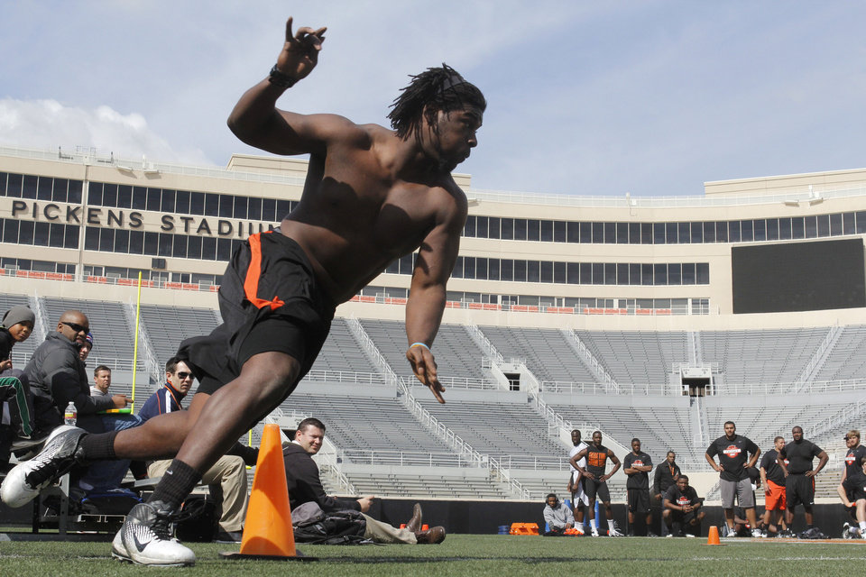 OSU's Nigel Nicholas rounds a cone as part of an agility exercise during Pro Day at Boone Pickens Stadium on the campus of Oklahoma State University in Stillwater, OK, Tuesday, March 12, 2013,  By Paul Hellstern, The Oklahoman