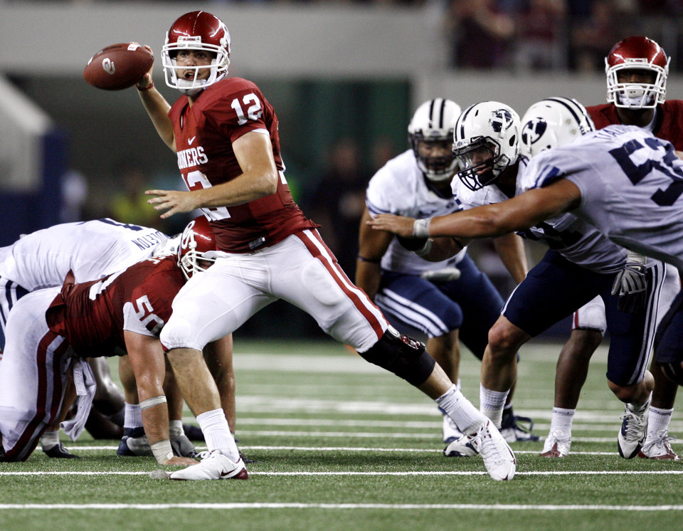 Landry Jones throws an incomplete pass during the final drive of second half of the college football game between the Brigham Young University Cougars (BYU) and the University of Oklahoma Sooners (OU) at Cowboys Stadium in Arlington, Texas, Saturday, September 5, 2009. By Steve Sisney, The Oklahoman ORG XMIT: KOD
