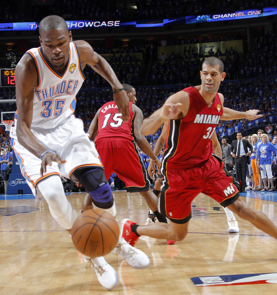 Oklahoma City's Kevin Durant (35) goes past Miami's Shane Battier (31) during Game 1 of the NBA Finals between the Oklahoma City Thunder and the Miami Heat at Chesapeake Energy Arena in Oklahoma City, Tuesday, June 12, 2012. Photo by Chris Landsberger, The Oklahoman