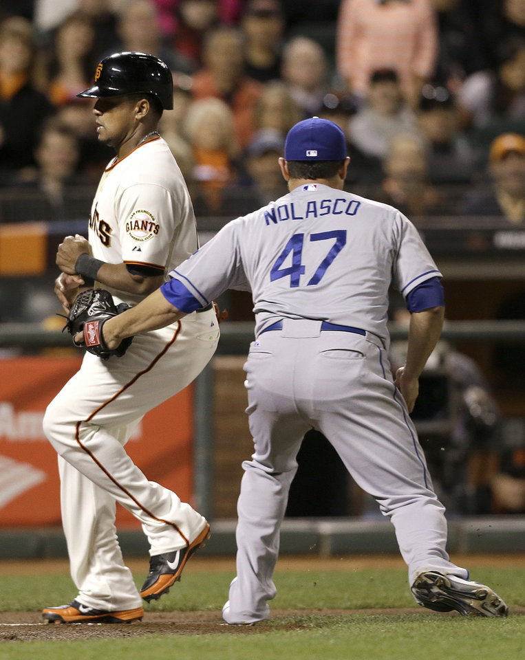 Photo - Los Angeles Dodgers pitcher Ricky Nolasco (47) tags out San Francisco Giants' Tony Abreu between third base and home plate during the second inning of a baseball game in San Francisco, Wednesday, Sept. 25, 2013. (AP Photo/Jeff Chiu)