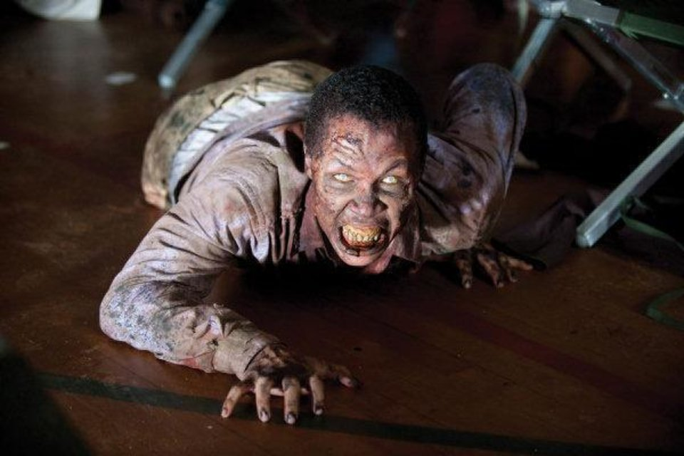 Photo - In this image released by AMC, a zombie appears in a scene from the second season of the AMC original series,