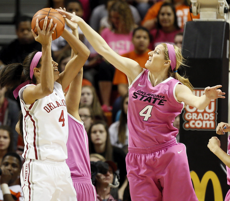 Photo - Oklahoma State's Liz Donohoe (4), right, defends a shot by Oklahoma's Nicole Griffin (4) in the first half during the women's Bedlam college basketball game between the OU Sooners and the OSU Cowgirls at Gallagher-Iba Arena in Stillwater, Okla., Sunday, Feb. 16, 2014. Photo by Nate Billings, The Oklahoman