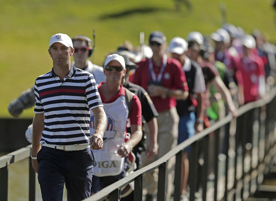 USA's Dustin Johnson walks across the bridge on the 13th hole during a singles match at the Ryder Cup PGA golf tournament Sunday, Sept. 30, 2012, at the Medinah Country Club in Medinah, Ill. (AP Photo/Charlie Riedel)  ORG XMIT: PGA155