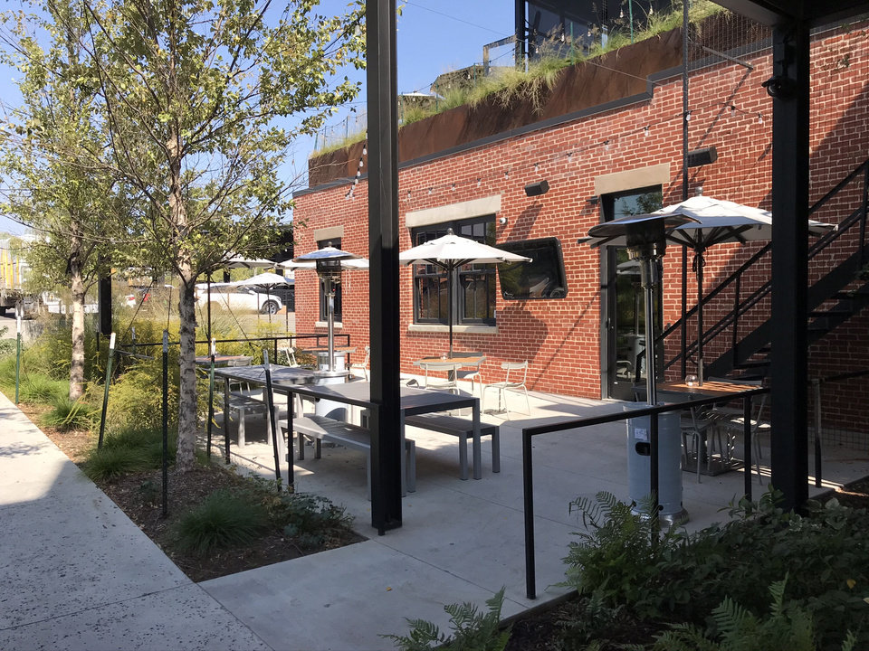 Photo - The garden patio at downtown Oklahoma City's Parlor food hall. [Dave Cathey/The Oklahoman]