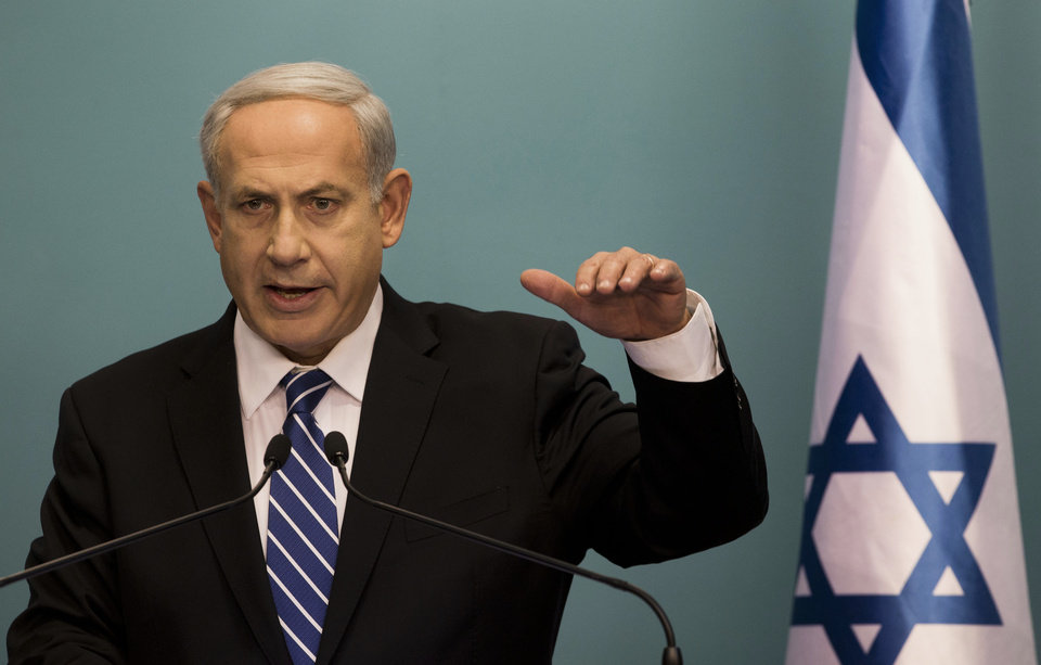 Photo -   Israeli Prime Minister Benjamin Netanyahu speaks during a press conference at the Prime Minister's office in Jerusalem, Tuesday, Oct. 9, 2012. Netanyahu has ordered new parliamentary elections in early 2013, roughly eight months ahead of schedule. (AP Photo/Bernat Armangue)