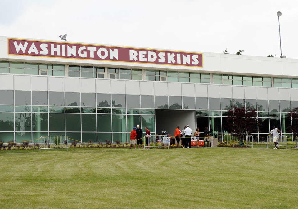 Photo - The Washington Redskins name is displayed on a building at their training facility at Redskins Park during NFL football minicamp, Wednesday, June 18, 2014, in Ashburn, Va. The U.S. Patent Office ruled Wednesday, June 18, 2014, that the Washington Redskins nickname is