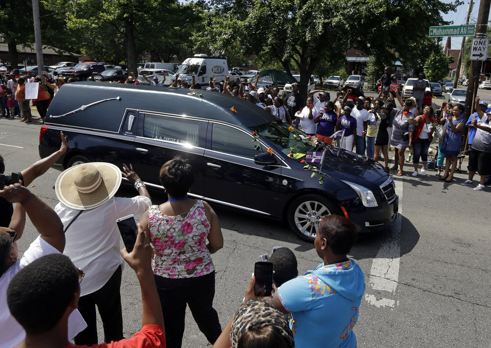 Photo - The hearse carrying Muhammad Ali makes its way down Muhammad Ali Boulevard in Louisville, Ky. Friday, June 10, 2016. (AP Photo/Michael Conroy)
