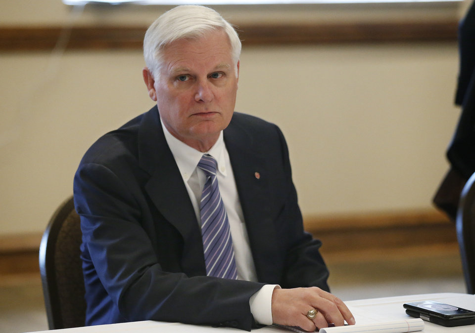 Photo - In this Thursday, May 9, 2019, photo, University of Oklahoma President James L. Gallogly is pictured before a Board of Regents meeting in Norman, Okla. Gallogly, a former energy industry executive who came out of retirement to succeed David Boren as the university's president, said in a statement released Sunday, May 12, that he has advised the university's regents of his plans to retire once they have a transition plan in place. He took on the position last year. (AP Photo/Sue Ogrocki)