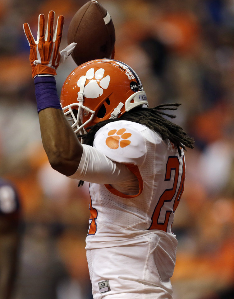 Photo - Clemson running back Zac Brooks (24) celebrates his touchdown against Syracuse during the first half of an NCAA college football game on Saturday, Oct. 5, 2013, in Syracuse, N.Y. (AP Photo/Mike Groll)