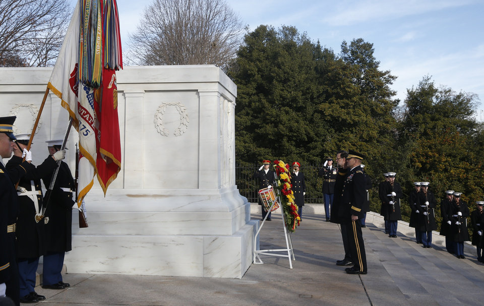 Photo - Spanish Prime Minister Mariano Rajoy, center, is accompanied by Army Maj. Gen. Jeffrey S. Buchanan, center right, as he lays a wreath at the Tomb of the Unknowns at Arlington National Cemetery, Monday, Jan. 13, 2014. Rajoy is in Washington to meet with President Barack Obama to discuss their support for the Transatlantic Trade and Investment Partnership, a proposed U.S.-European Union trade agreement currently in the midst of negotiations, and discuss promoting economic growth and jobs, cooperation within the North Atlantic Treaty Organization, their common interests in Latin America and challenges in North Africa and the Middle East. (AP Photo/Charles Dharapak)