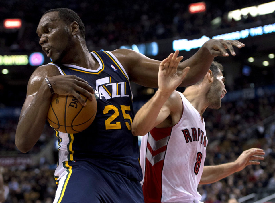 Utah Jazz center Al Jefferson (25) rebounds against Toronto Raptors guard Jose Calderon (8) during the first half of an NBA basketball game, Monday, Nov. 12, 2012, in Toronto. (AP Photo/The Canadian Press, Frank Gunn)