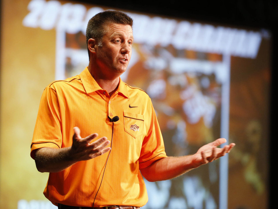 OSU Football Head Coach Mike Gundy speaks to a crowd at the Renaissance Hotel in Tulsa, Okla., taken on July 29,2013, during the Cowboy Caravan tour. JAMES GIBBARD/Tulsa World
