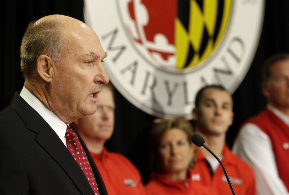 Big Ten Commissioner James Delany, left, speaks at a news conference to announce the University of Maryland's decision to move to the Big Ten in College Park, Md., Monday, Nov. 19, 2012. Maryland is joining the Big Ten, leaving the Atlantic Coast Conference in a shocker of a move in the world of conference realignment that was driven by the school's budget woes. (AP Photo/Patrick Semansky)