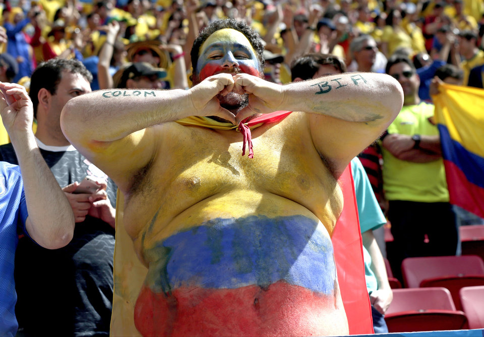 Photo - A Colombian supporter gestures before the group C World Cup soccer match between Colombia and Ivory Coast at the Estadio Nacional in Brasilia, Brazil, Thursday, June 19, 2014.  (AP Photo/Marcio Jose Sanchez)