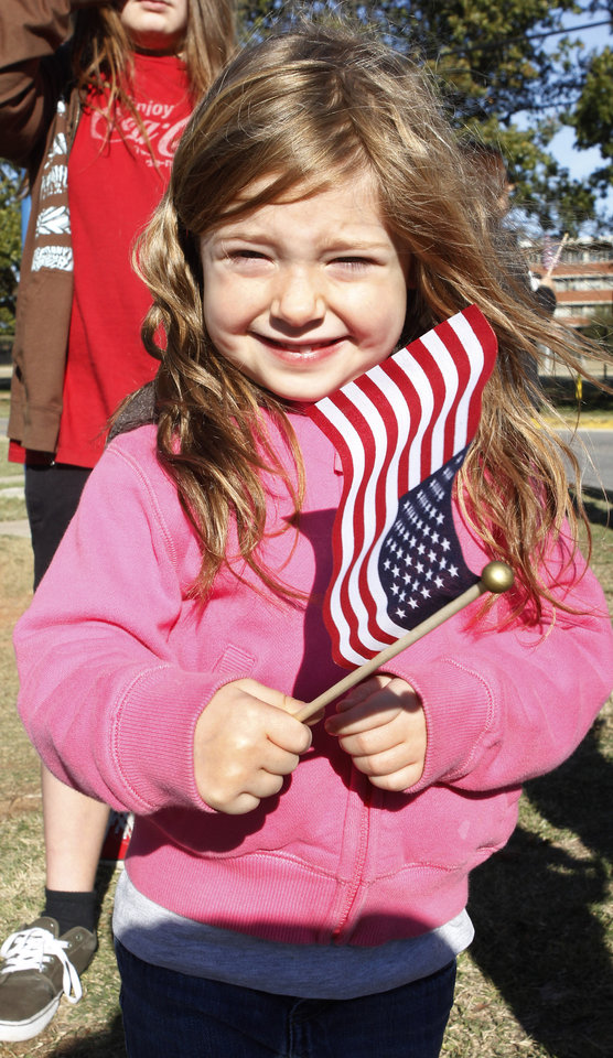 Photo - Avery Zike, 4 from Blanchard, waves an American flag while watching the Veterans Day Parade in Norman Friday, Nov. 11, 2011. Photo by Paul B. Southerland, The Oklahoman