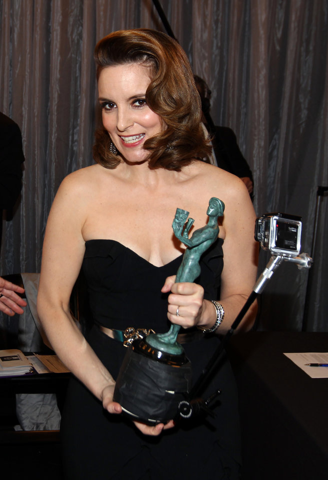 Tina Fey is seen backstage with the award for outstanding female actor in a comedy series for �30 Rock� at the 19th Annual Screen Actors Guild Awards at the Shrine Auditorium in Los Angeles on Sunday Jan. 27, 2013. (Photo by Matt Sayles/Invision/AP)
