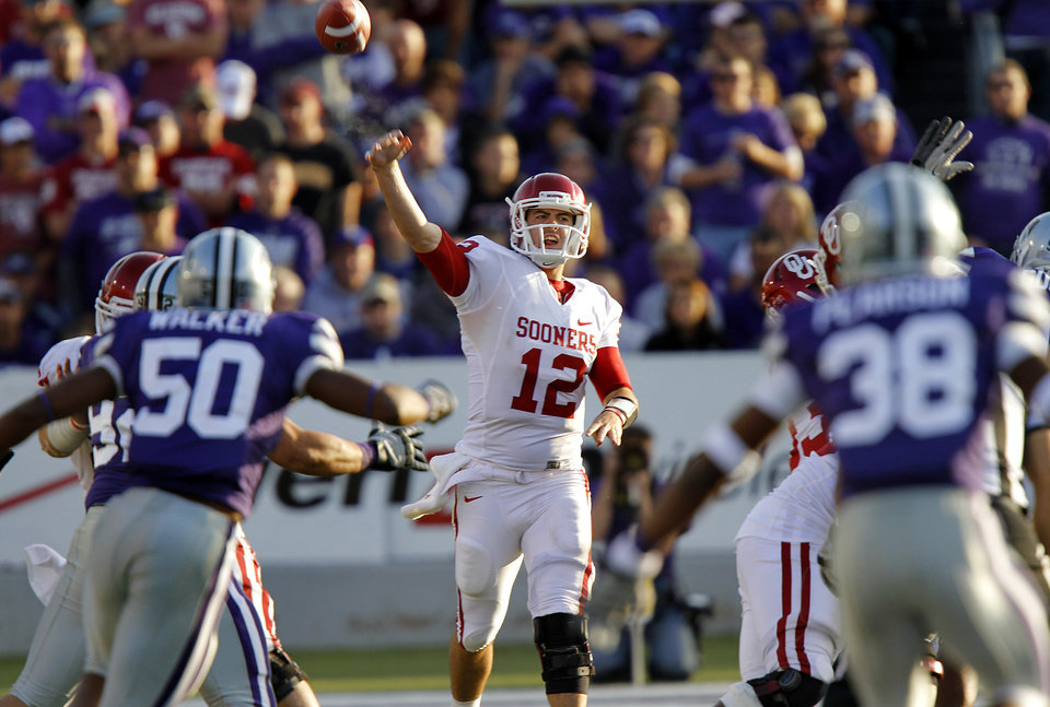 Photo - Oklahoma Sooners' Landry Jones (12) throws the ball during the college football game between the University of Oklahoma Sooners (OU) and the Kansas State University Wildcats (KSU) at Bill Snyder Family Stadium on Saturday, Oct. 29, 2011. in Manhattan, Kan. Photo by Chris Landsberger, The Oklahoman  ORG XMIT: KOD