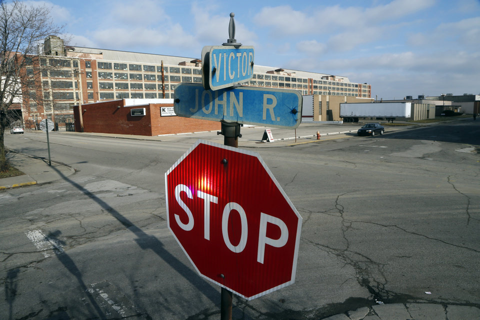 Photo - This Dec. 18, 2012 photo shows the intersection of John R. and Victor streets near the site of the country's first mosque led by The Rev. Imam Hussien Karoub, in the shadow of the Ford Motor Co.'s Model T plant, background, in Highland Park, Mich. (AP Photo/Carlos Osorio)