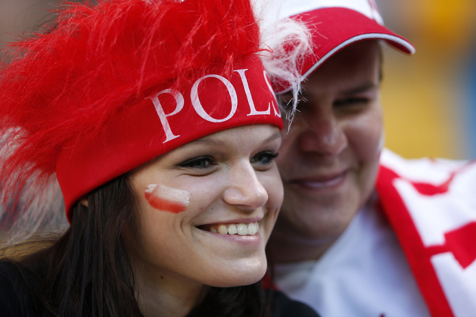 <p>Fans wear the colors of Poland on the stands during the Euro 2012 soccer championship Group B match between Denmark and Portugal in Lviv, Ukraine, Wednesday, June 13, 2012. (AP Photo/Armando Franca)</p>
