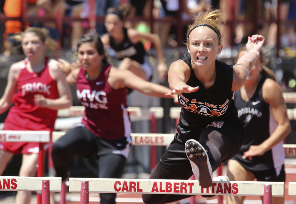 Photo - Holly Anderson of Alex wins the 100 meter hurdles at Carl Albert high school in Midwest City, Friday May 09, 2014. Photo By Steve Gooch, The Oklahoman