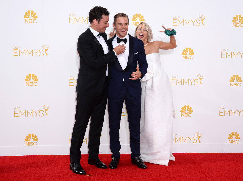 Photo - Jimmy Fallon, from left, Derek Hough and Julianne Hough arrive at the 66th Annual Primetime Emmy Awards at the Nokia Theatre L.A. Live on Monday, Aug. 25, 2014, in Los Angeles. (Photo by Jordan Strauss/Invision/AP)