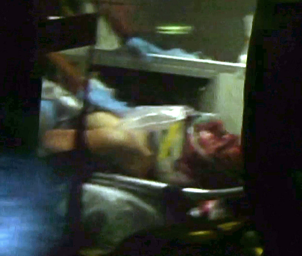 This still frame from video shows Boston Marathon bombing suspect Dzhokhar Tsarnaev visible through an ambulance after he was captured in Watertown, Mass., Friday, April 19, 2013. A 19-year-old college student wanted in the Boston Marathon bombings was taken into custody Friday evening after a manhunt that left the city virtually paralyzed and his older brother and accomplice dead.  (AP Photo/Robert Ray) ORG XMIT: WX813