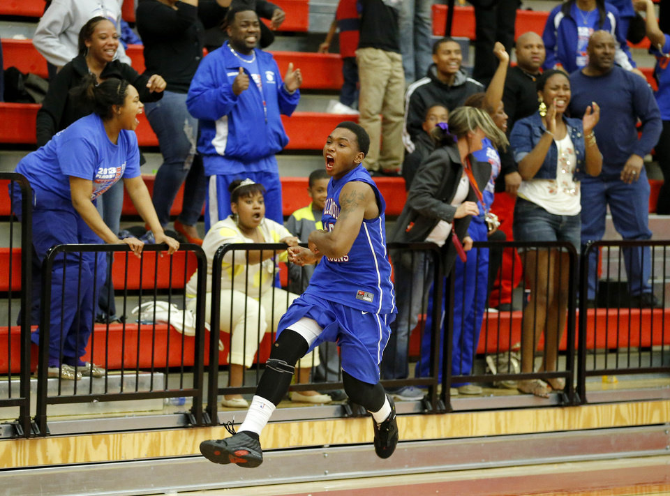 Photo - Millwood's Chris Cook celebrates Millwood's win in a Class 3A boys state basketball tournament game between Hugo and Millwood at Yukon High School in Yukon, Okla., Thursday, March 7, 2013. Photo by Bryan Terry, The Oklahoman