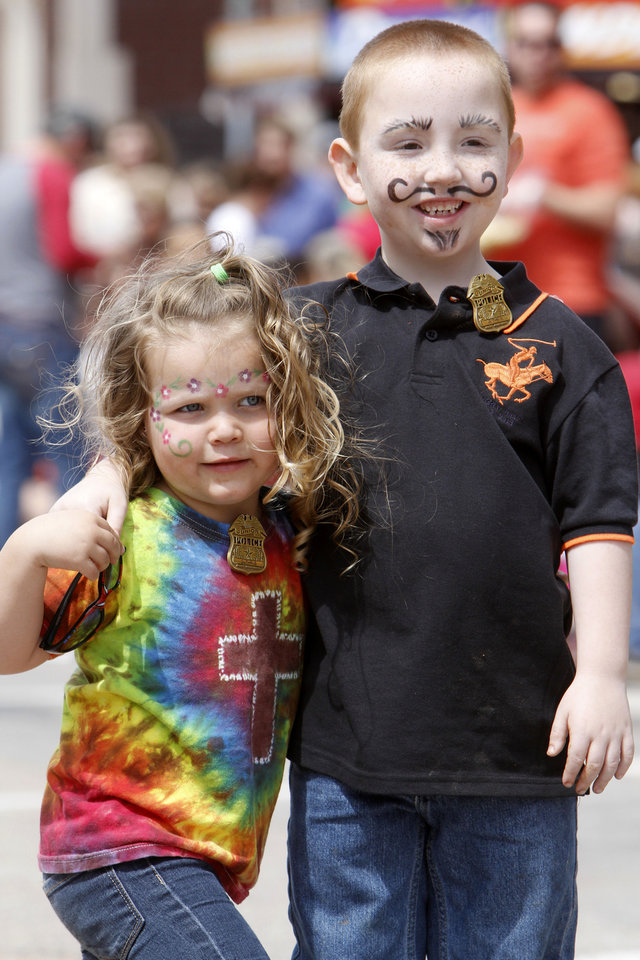 Three year old Ella Gamble and her seven year old brother Brayden watch the 89ers Day Parade in Guthrie, OK, Saturday, April 20, 2013,  By Paul Hellstern, The Oklahoman