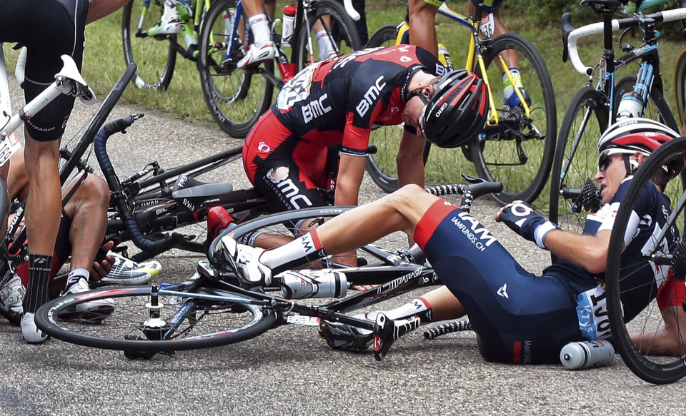 Photo - Tejay van Garderen of the U.S., center top, and Switzerland's Sebastien Reichenbach, right, crash during the seventh stage of the Tour de France cycling race over 234.5 kilometers (145.7 miles) with start in Epernay and finish in Nancy, France, Friday, July 11, 2014. (AP Photo/Fred Mons, Pool)