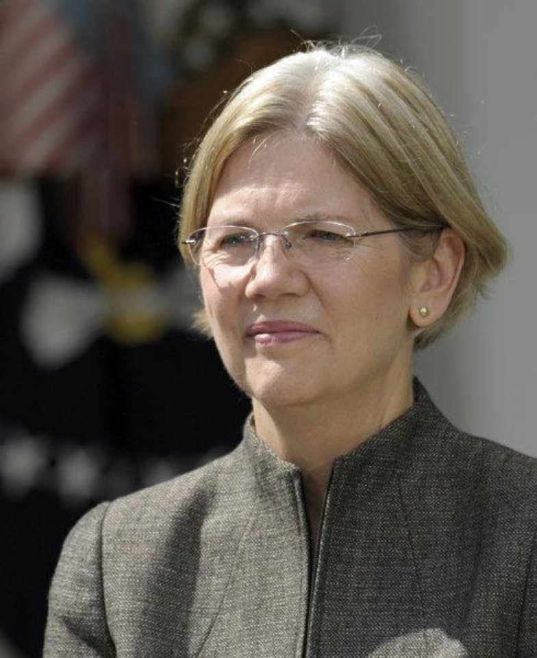 Photo - Elizabeth Warren is seen in the Rose Garden of the White House in Washington, Friday, Sept. 17, 2010, where President Barack Obama announces that she will head the Consumer Financial Protection Bureau. (AP Photo/Susan Walsh) ORG XMIT: DCSW108