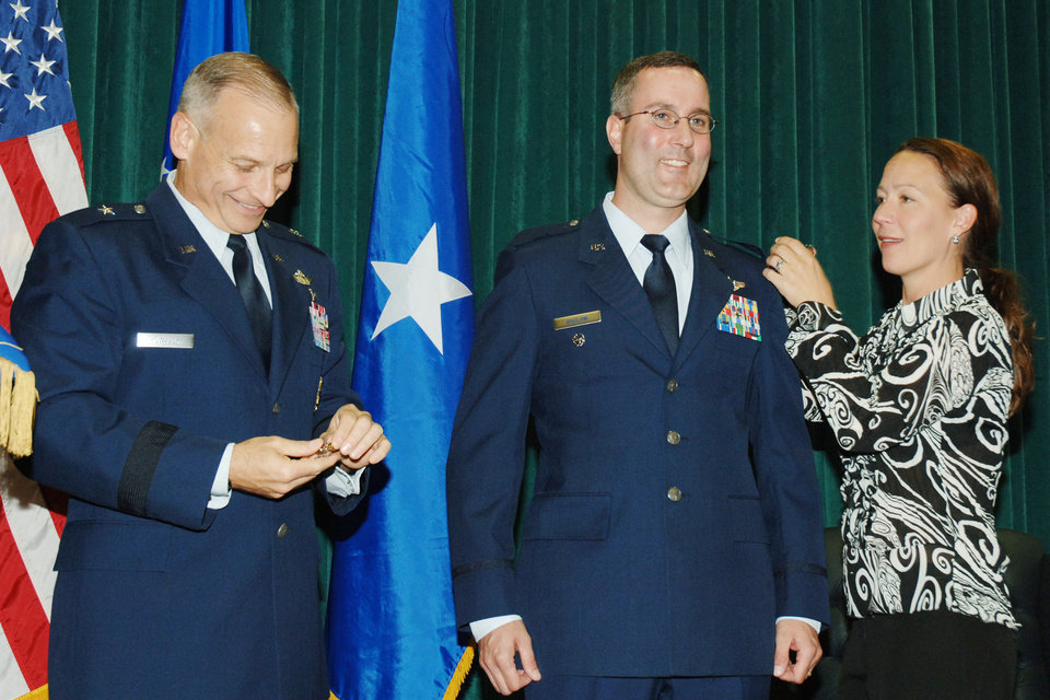 Patrick Raglow, center, receives a military honor in this photograph that includes his wife, Andrea at right. Photo provided <strong></strong>