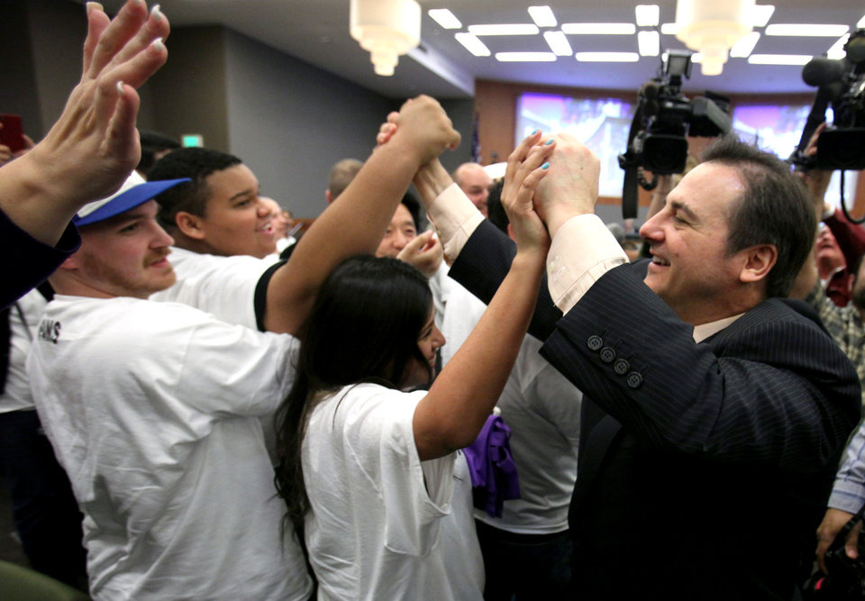Photo - FILE - In this March 6, 2012, file photo, Gavin Maloof, right, co-owner of the Sacramento Kings, celebrates with Kings fans after the Sacramento City Council approved a plan to help finance a new arena, in Sacramento, Calif.  After backing out of the deal to build a new arena in Sacramento and announcing the sale of the Kings to a group that wants to move the team to Seattle, the Maloof brothers have become the city's most-reviled villains heading into a preliminary NBA meeting on the issue Wednesday, April 3, 2013, in New York. (AP Photo/Rich Pedroncelli, File)
