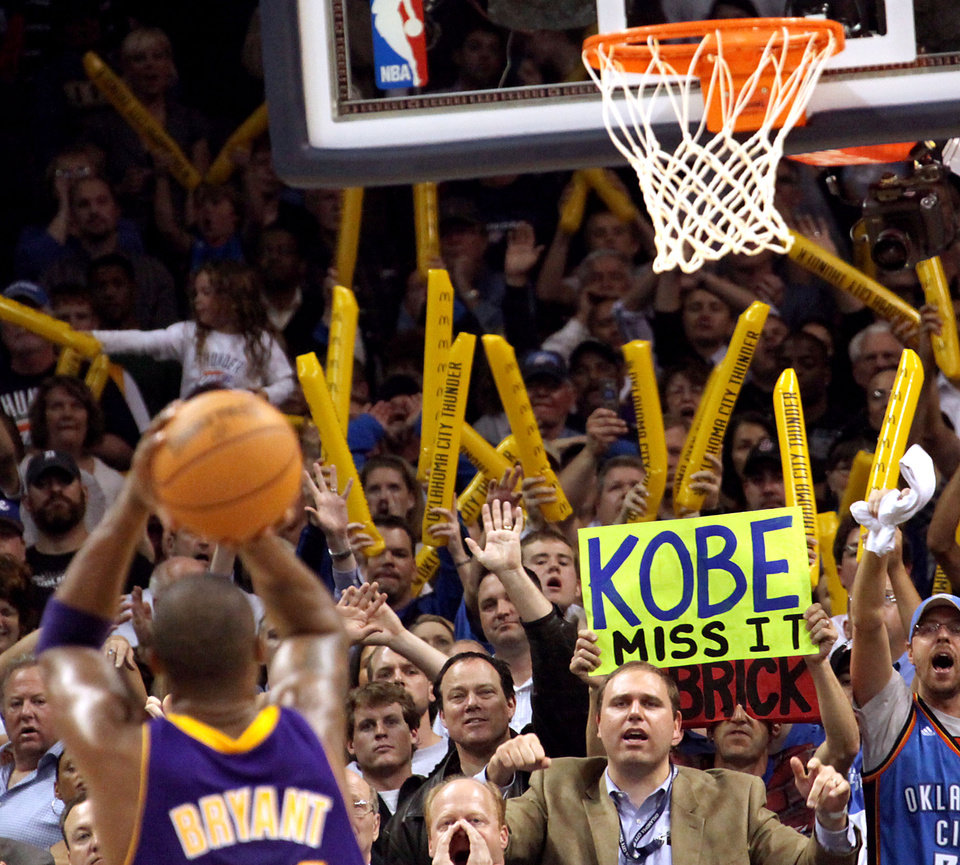 Photo - Derrick Seys, of Edmond, holds a sign for Kobe Bryant as Seys and Oklahoma City fans taunt the Los Angeles Lakers during the NBA basketball game between the Los Angeles Lakers and the Oklahoma City Thunder at the Ford Center in Oklahoma City, on Tuesday, Nov. 3, 2009. The Thunder lost to the Lakers  By John Clanton, The Oklahoman  ORG XMIT: KOD