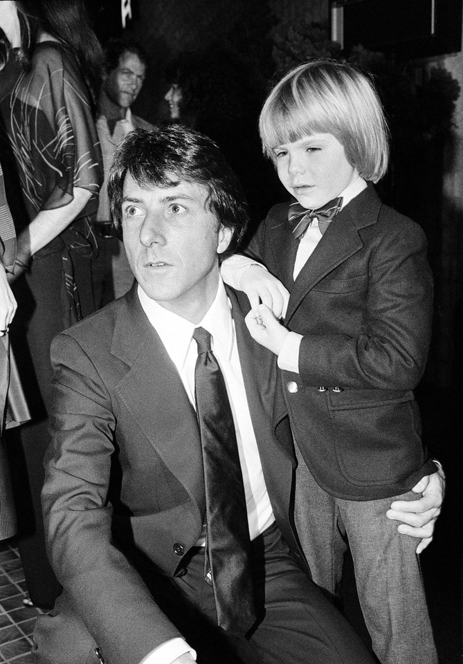 Photo - FILE - In this December 5, 1979 file photo, actor Dustin Hoffman, left, and supporting actor, Justin Henry, 6, are seen at the premiere of their motion picture,
