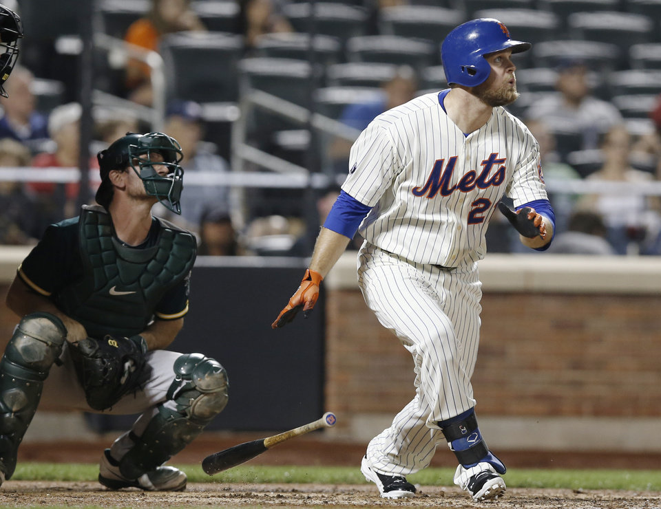Photo - Oakland Athletics catcher John Jaso  watches along with New York Mets pinch hitter Lucas Duda who hit a seventh-inning, three-run home run chasing Oakland Athletics starting pitcher Brad Mills in an interleague baseball game in New York, Wednesday, June 25, 2014. (AP Photo/Kathy Willens)