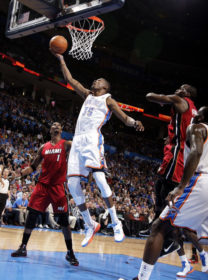 Photo - Oklahoma City's Kevin Durant shoots a lay up during the NBA basketball game between the Miami Heat and the Oklahoma City Thunder at Chesapeake Energy Arena in Oklahoma City, Sunday, March 25, 2012. Photo by Sarah Phipps The Oklahoman
