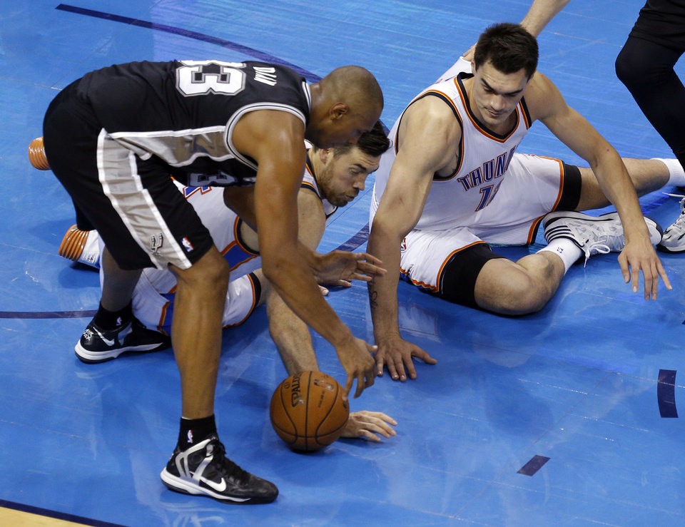 Photo - Oklahoma City's Nick Collison (4), Steven Adams (12) and San Antonio's Boris Diaw (33) fight for a loose ball during Game 4 of the Western Conference Finals in the NBA playoffs between the Oklahoma City Thunder and the San Antonio Spurs at Chesapeake Energy Arena in Oklahoma City, Tuesday, May 27, 2014. Photo by Bryan Terry, The Oklahoman