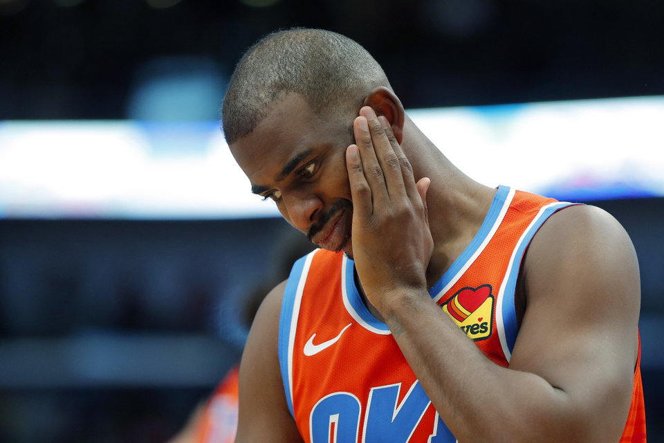 Photo - Oklahoma City Thunder guard Chris Paul reacts after taking a hand to the face and drawing a foul in the second half of an NBA basketball game against the New Orleans Pelicans in New Orleans, Sunday, Dec. 1, 2019. The Thunder won 107-104. (AP Photo/Gerald Herbert)