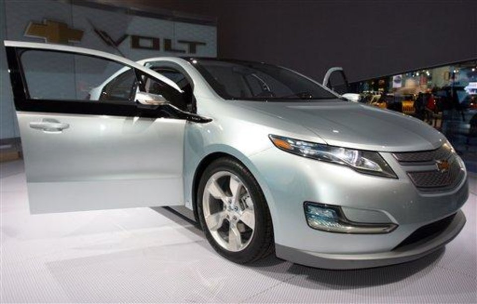 FILE - In this Jan. 17, 2009 file photo, General Motors' Chevy Volt is seen on display during opening day of the North American International Auto Show in Detroit. General Motors Corp. will assemble battery packs for its new rechargeable electric car at a facility south of Detroit, creating about 100 jobs, a person briefed on the plans said Friday, July 17, 2009. (AP Photo/Jerry S. Mendoza, file)