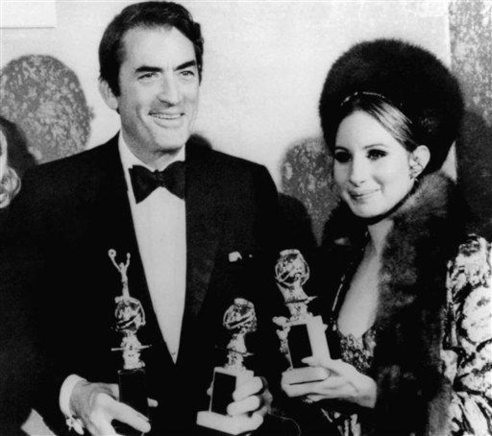 Gregory Peck and Barbra Streisand hold the Golden Globes they won Feb. 24, 1969 in Hollywood from the Foreign Press Association at the group\'s annual awards banquet. Peck was awarded the Cecil B. DeMille Award for outstanding achievement. (AP Photo)