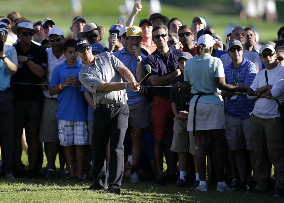 Photo - Hunter Mahan hits from the rough on the 18th hole during the final round of play at The Barclays golf tournament Sunday, Aug. 24, 2014, in Paramus, N.J. Mahan won the tournament with a 14 under-par 270. (AP Photo/Mel Evans)
