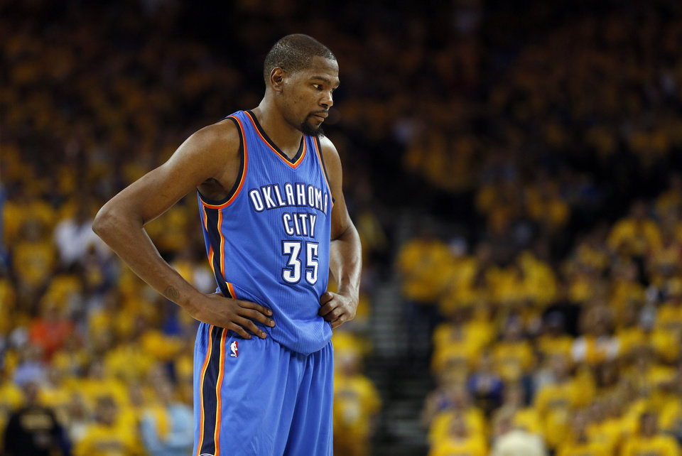 Photo -  Oklahoma City's Kevin Durant (35) stands on the court after fouling Golden State's Stephen Curry (30), not pictured, on a three-point shot and being called for a technical foul in the third quarter during Game 2 of the Western Conference finals in the NBA playoffs between the Oklahoma City Thunder and the Golden State Warriors at Oracle Arena in Oakland, Calif., Wednesday, May 18, 2016. Golden State won 118-91. Photo by Nate Billings, The Oklahoman