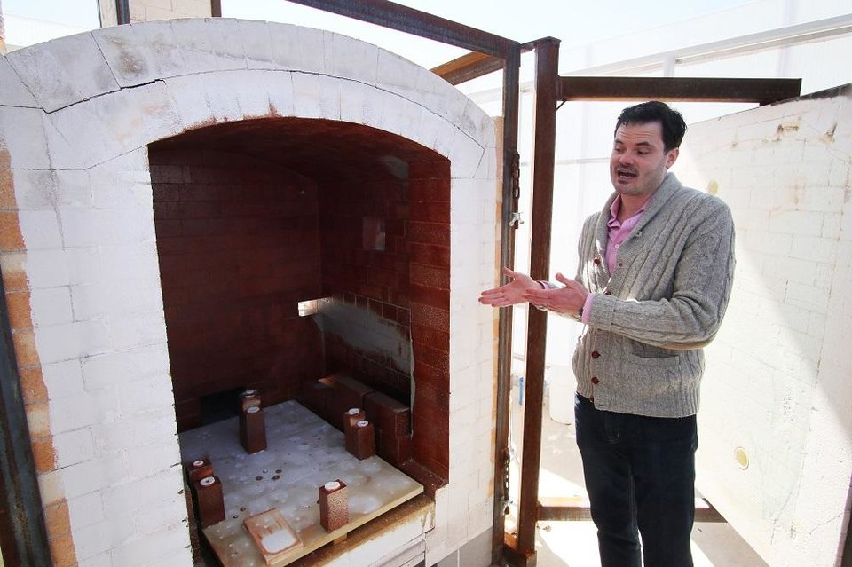 Photo -  Artistic Director Jeremiah Matthew Davis talks about the new soda kiln at the new Oklahoma Contemporary Arts Center, Monday, March 9, 2020. The soda kiln is believed to be the only publicly accessible one of its kind in the region. [Photo by Doug Hoke/The Oklahoman]