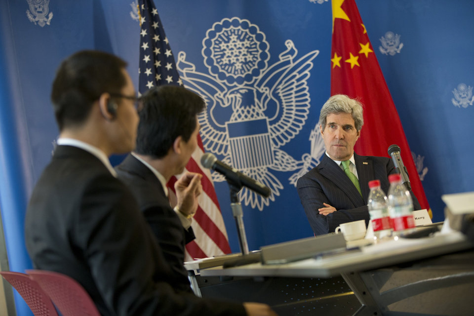 Photo - U.S. Secretary of State John Kerry, right, listens to a question during a discussion with Chinese bloggers on a number of issues, including internet freedom, Chinese territorial disputes with Japan, North Korea, and human rights, on Saturday, Feb. 15, 2014, in Beijing, China. (AP Photo/Evan Vucci, Pool)